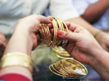 Don't rush to buy gold just yet