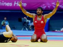 India's Yogeshwar Dutt celebrates after defeating Tajikistan's Zalimkhan Yusupov, winning gold medal in the men's 65 kg freestyle wrestling match at Dowon Gymnasium Stadium at 17th Asian Games in Incheon
