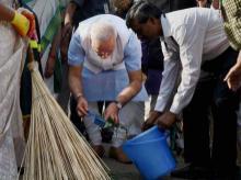 Prime Minister Narendra Modi kicks off the Swachh Bharat campaign in New Delhi's Balmiki Basti on Thursday