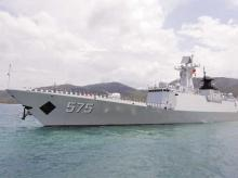 Chinese navy sailors wave as Chinese naval missile frigate Yueyang departs for the Rim of the Pacific exercise, at a military port in Sanya, Hainan province, in 2014