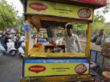 A vendor works at a roadside Maggi noodles eatery in Ahmedabad