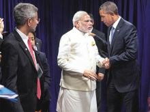 US President Barack Obama (right) and Prime Minister Narendra Modi after a meeting at the United Nations headquarters in New York on Monday.  Foreign Secretary of India S Jaishankar (left) is also seen