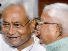 Nitish Kumar and Lalu Prasad Yadav celebrate victory in bihar elections
