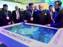 Prime Minister Narendra Modi with Minister of State for Environment, Forest and Climate Change Prakash Javadekar going around after the inauguration of the India Pavilion at the COP21, United Nations Climate Change Conference, in Le Bourget, outside
