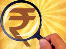Currency, bonds: Rupee beats global storm