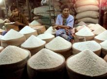 A rice trader waits for customers at a market in the Bangladesh capital Dhaka