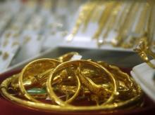 Gold products are displayed for sale at a shop in Hanoi. Photo: Reuters