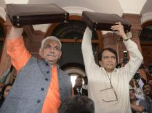 Union Minister for Railways, Suresh Prabhu along with MOS Manoj Sinha arrive at Parliament for presenting the Railway Budget 2016-17, in New Delhi (pic: Sanjay