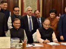 Union Minister for Finance, Arun Jaitley giving final touches to the Union Budget as MoS Finance Jayant Sinha and his full budget team look on at North Block in New Delhi