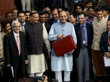 Finance Minister Arun Jaitley along with his budget team leave from North Block to meet President before presenting the Union Budget 2016-17, in New Delhi