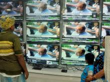 People watching the Union Budget 2016-17 presentation by Finance Minister Arun Jaitely on TV sets, at a showroom in Kolkata