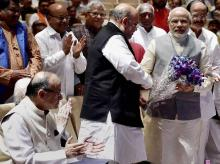 Prime Minister Narendra Modi being greeted by BJP president Amit Shah at a meeting of ruling National Democratic Alliance MP's in New Delhi. lso seen in the picture are Finance Minister Arun Jaitley and other leaders.