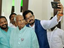 BJP's Thiruvananthapuram central candidate S Sreesanth takes a selfie with the party's winning candidate O Rajagopal at the party headquarters in Thiruvananthapuram
