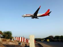 A SpiceJet passenger aircraft prepares to land at Sardar Vallabhbhai Patel international airport in Ahmedabad
