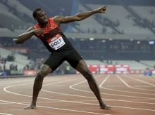 Usain Bolt of Jamaica poses for photographers after he won the men's 200 meter race during the Diamond League anniversary games at The Stadium, in the Queen Elizabeth Olympic Park in London.