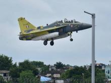 IAF fighter plane Tejas, lands at Raja Bhoj Airport in Bhopal. Tejas is set go to Leh airbase from Bengaluru through Bhopal.