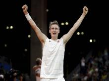 Denmark's Viktor Axelsen celebrates after defeating China's Lin Dan to win the men's badminton singles bronze medal match at the 2016 Summer Olympics