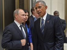 File photo of Russian President Vladimir Putin, left, and US President Barack Obama. Photo PTI