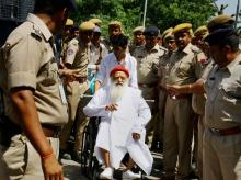 Asaram Bapu on wheel chair at the Jodhpur airport as he is being taken to Delhi for medical check up in AIIMS from Jodhpur, Rajasthan.