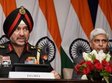 Director General Military Operations Ranbir Singh salutes after the press conference along with External Affairs Spokesperson Vikas Swarup in New Delhi. India conducted Surgical strikes across the LoC in Kashmir.