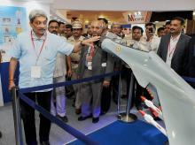 Union Defence Minister Manohar Parrikar looking at exhibits during the inauguration of METand HTS 2016 exibition in Vashi, New Mumbai. Photo: PTI