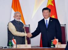 Prime Minister Narendra Modi with Chinese President Xi Jinping at the agreements exchange ceremony during BRICS Summit in Benaulim, Goa.Photo: PTI