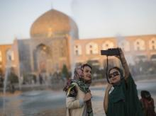 Tourists take a selfie near the water fountains on Naqsh-e-Jahan square in Isfahan, Iran. Photo: Bloomberg