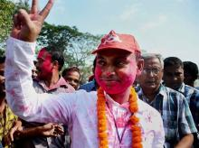 CPI(M)'s Jhumu Sarkar celebrates victory in assembly bypolls at Barjala constituency in Agartala on Tuesday.