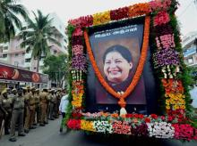 Security men guard during an AIADMK rally to pay tribute J Jayalalithaa in Coimbatore. Photo: PTI