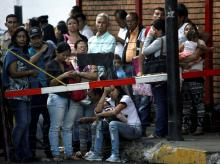 Desperate to dump soon-worthless cash, Venezuelans flock to banks