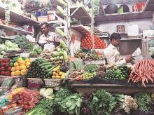 Vendors at a vegetable marketPhoto: Reuters
