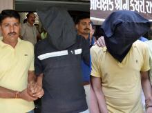 ISIS suspects Wasim Ramodiya and Naeem Ramodiya being taken away after they were arrested by Gujarat ATS in Rajkot. Photo: PTI