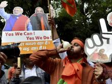 BJP supporters and workers celebrate party's victory in the assembly elections, at the party head quarters in New Delhi