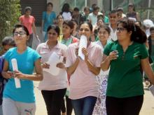 Students coming out after taking the 'National Eligibility Entrance Test (NEET) in Gurugram on Sunday. (Photo: PTI)
