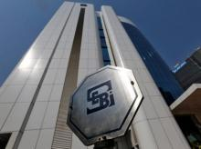 The logo of the Securities and Exchange Board of India (SEBI) is pictured on the premises of its headquarters in Mumbai (Photo: Reuters)