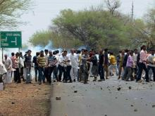 Farmers pelting stones as they clash with the police during their agitation in Phanda near Bhopal
