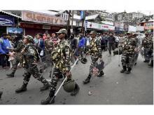 Security personnel patrol a road during GJM's strike in Darjeeling