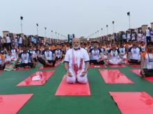Yoga a free life insurance, says Modi while performing asanas in Lucknow