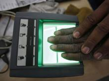 A villager goes through the process of a fingerprint scanner for the Unique Identification (UID) database system at an enrolment centre at Merta district in Rajasthan. (File photo: Reuters)