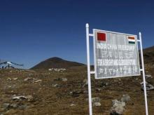 A signboard is seen from the Indian side of the Indo-China border at Bumla, in the northeastern Indian state of Arunachal Pradesh. Photo: Reuters