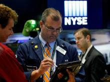 Traders work on the floor of the New York Stock Exchange (NYSE) in New York. (File Photo: Reuters)