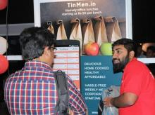 TinMen founder Mukesh Manda (right) explaining an early version of  the app to a user