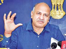 'Not satisfied with GST Council's decision: Manish Sisodia