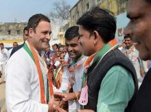Congress vice-president Rahul Gandhi greets party workers at a rally in Pavi Jetpur, Chhota Udaipur