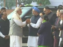 Prime Minister Narendra Modi meets former PM Manmohan Singh at the Parliament.