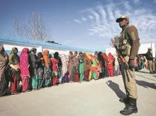 Voters line up to cast their votes. File photo: Reuters