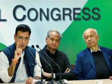 AICC spokesperson Randeep Singh Surjewala with party leaders Sushilkumar Shinde and Ashok Gehlot addressing the media at AICC headquarters, in New Delhi. Photo: PTI
