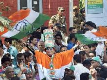 Congress party supporters celebrate after a party candidate's win in the Assembly elections, outside the Gujarat College counting centre in Amedabad on Monday