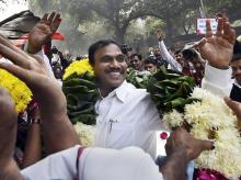 Former Telecom minister A Raja waves at his supporters after he was acquitted by a special court in the 2G scam case, in New Delhi. File Photo: PTI
