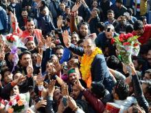 BJP's Jairam Thakur celebrates along with supporter after he was chosen as the party's Legislature party leader at a meeting, in Shimla. Photo: PTI